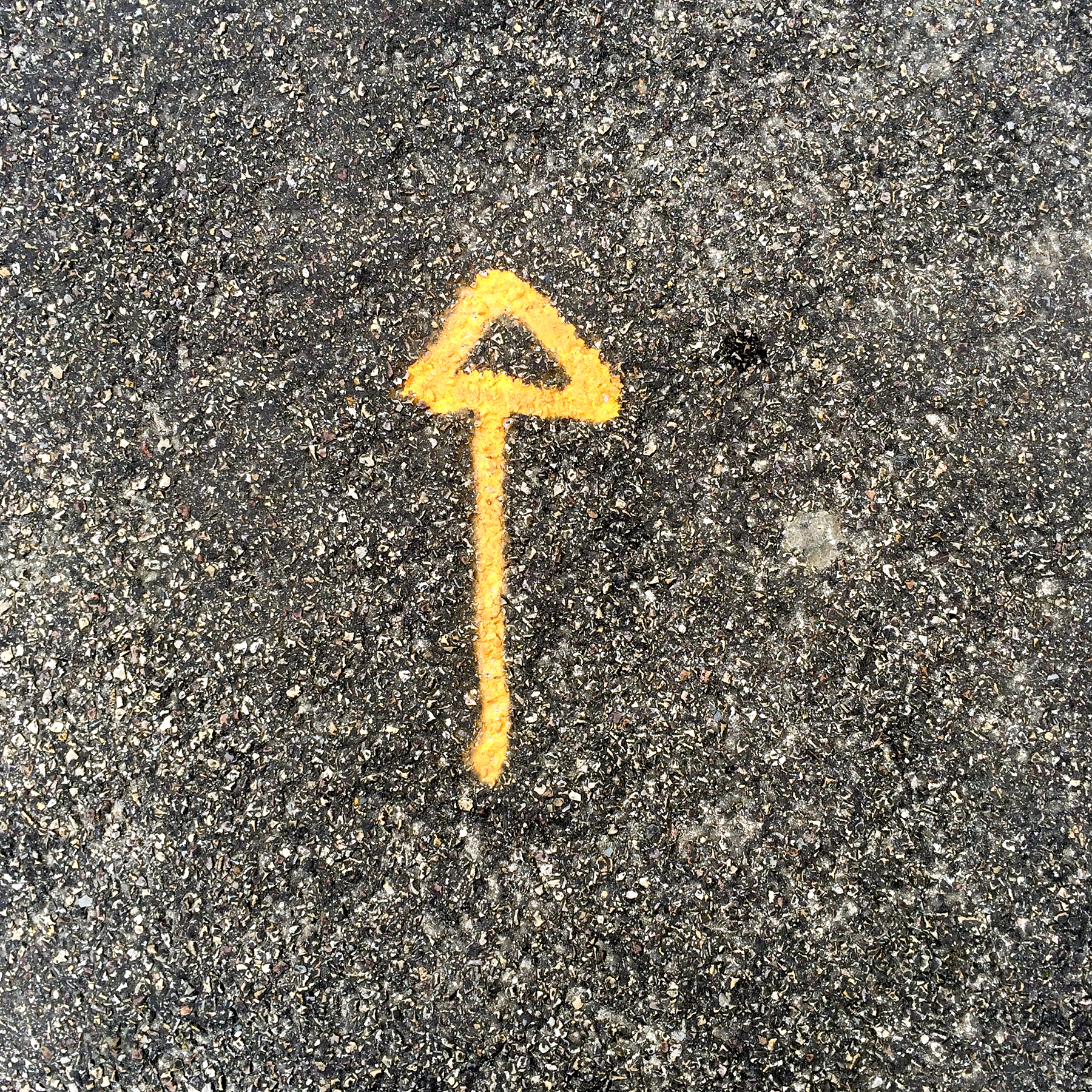 4th of 6 placeholder images: yellow arrow spraypainted on pavement