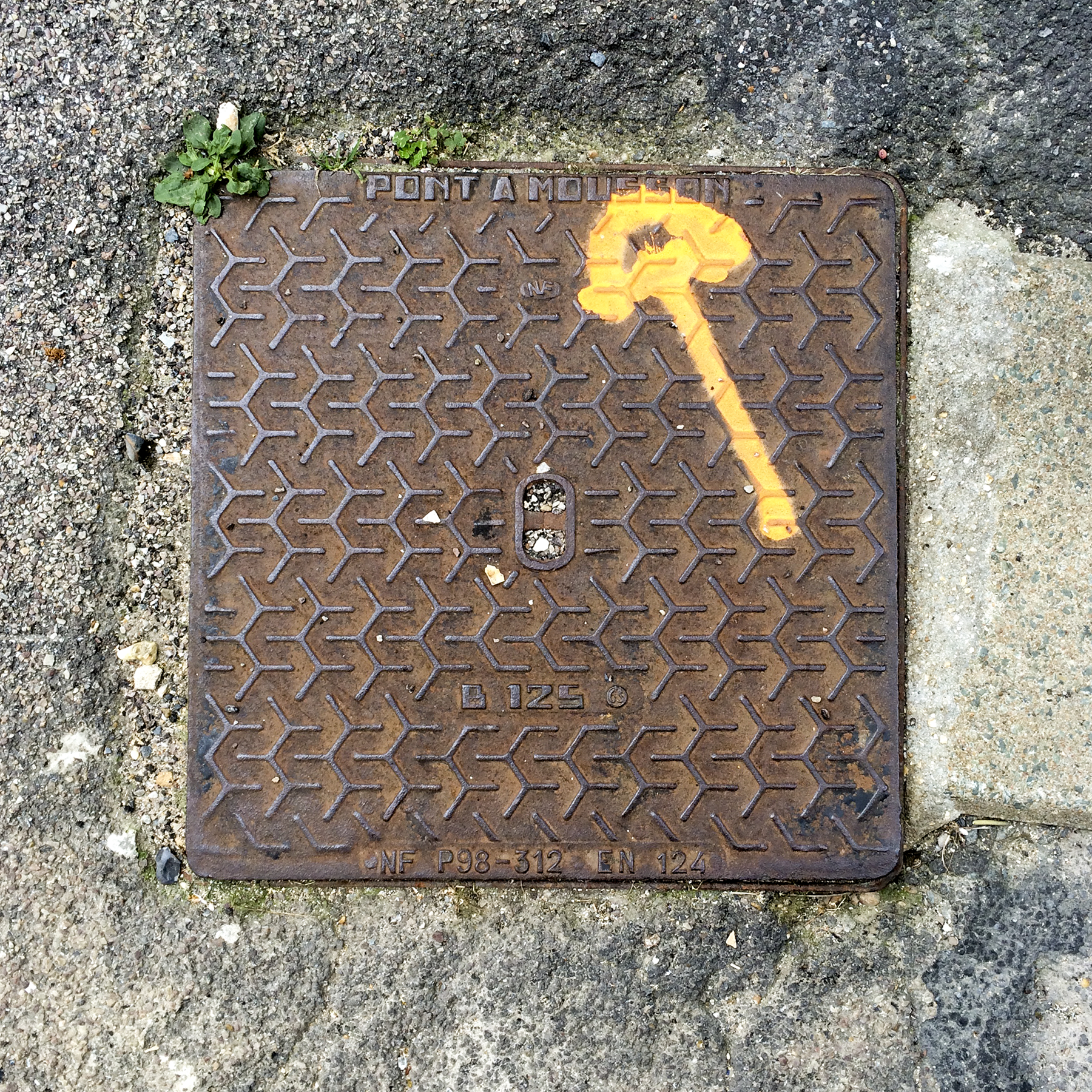 6th of 6 placeholder images: yellow arrow spraypainted on pavement